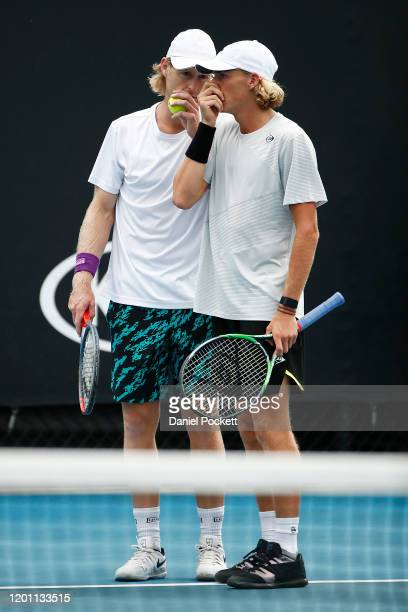 Max Purcell and Luke Saville of Australia talk tactics during their Men's Doubles first round match against Andrey Rublev of Russia and Andrei...