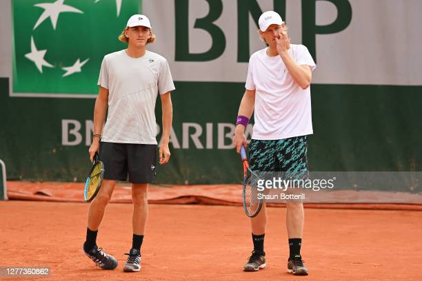 Max Purcell and Luke Saville of Australia talk tactics in their Men's Doubles first round match against Pierre-Hugues Herbert and Nicolas Mahut of...