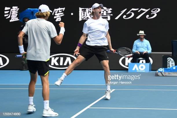 Max Purcell of Australia and Luke Saville of Australia celebrate after winning a point in their Men's Doubles Finals match against Rajeev Ram of the...