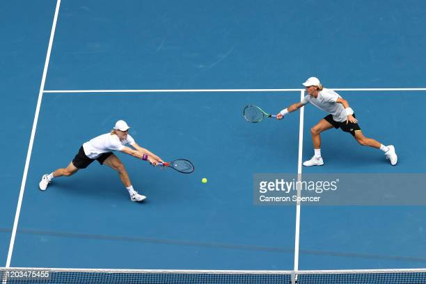 Max Purcell of Australia and Luke Saville of Australia play in their Men's Doubles Finals match against Rajeev Ram of the United States and Joe...
