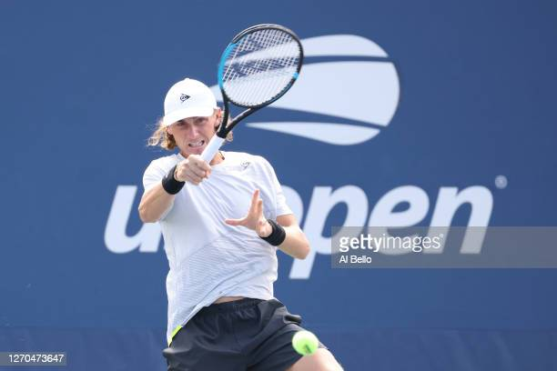 Max Purcell of Australia and Luke Saville of Australia return the ball during their Men's Doubles first round match against Kevin Krawietz of Germany...
