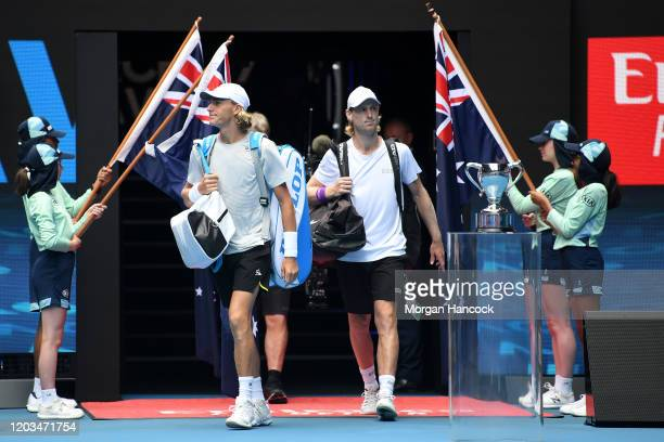 Max Purcell of Australia and Luke Saville of Australia walk onto court before their Men's Doubles Finals match against Rajeev Ram of the United...