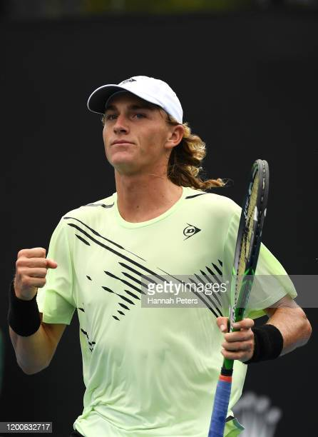 Max Purcell of Australia celebrates after winning a point during his Men's Singles first round match against Jannik Sinner of Italy on day one of the...