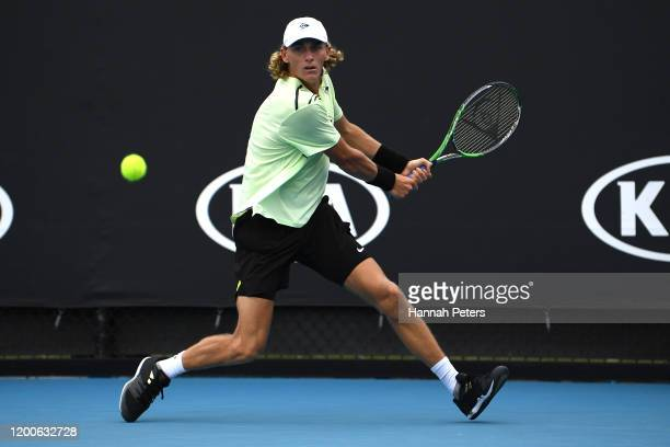 Max Purcell of Australia plays a backhand during his Men's Singles first round match against Jannik Sinner of Italy on day one of the 2020 Australian...