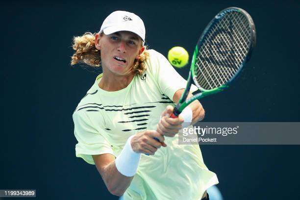Max Purcell of Australia plays a backhand in his match against Andrea Collarini of Argentina during 2020 Australian Open Qualifying at Melbourne Park...