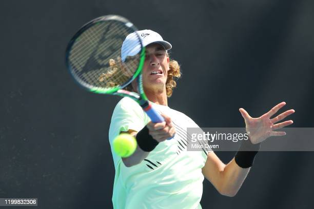 Max Purcell of Australia plays a forehand in his match against Gianluca Mager of Italy during 2020 Australian Open Qualifying at Melbourne Park on...