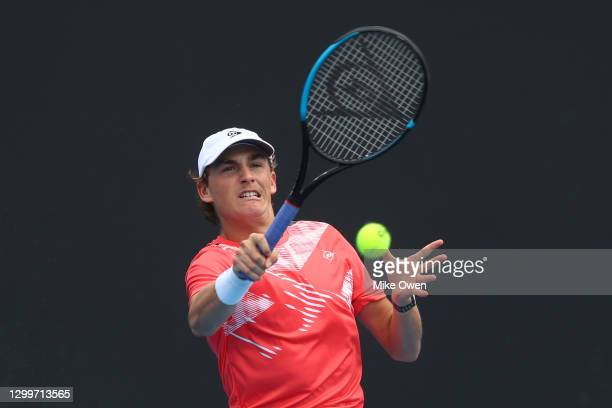 Max Purcell of Australia plays a forehand in his match Norbert Gombos of Slovakia during day one of the ATP 250 Great Ocean Road Open at Melbourne...