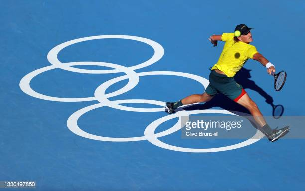 Max Purcell of Team Australia plays a backhand during his Men's Singles First Round match against Felix Auger-Aliassime of Team Canada on day two of...