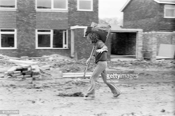 Max Quarterman the 33 year old plasterer's mate who earns up to ú400 a week pictured carrying his hod on a building site at Hazelmere near High...
