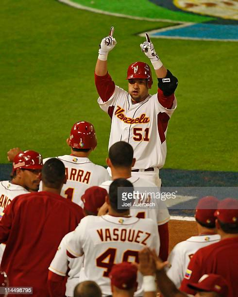 Max Ramirez of Venezuela celebrates his three run home run against the USA as he crosses home plate during the World Baseball Classic at Dolphin...