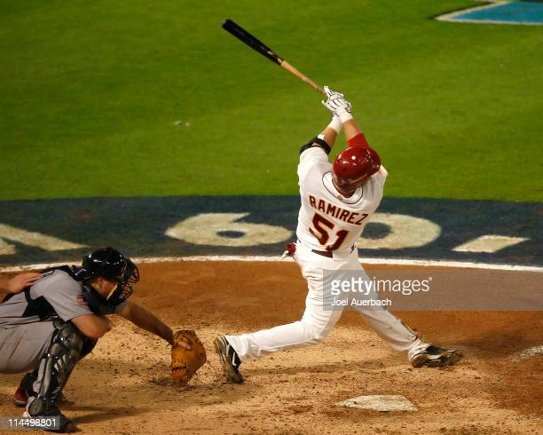 Max Ramirez of Venezuela hits a three run home run against the USA during the World Baseball Classic at Dolphin Stadium on March 18 2009 in Miami...