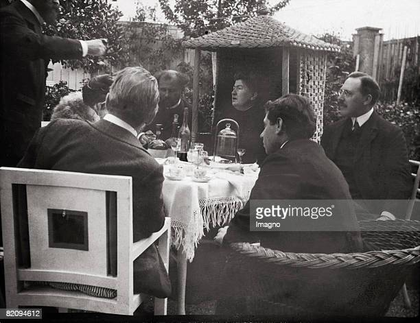 Max Reinhardt Carl Moll Alma Schindler Mahler Gustav Klimt Anna Moll and Josef Hofmann are sitting in the garden of the Villa Carl Moll Photograph by...