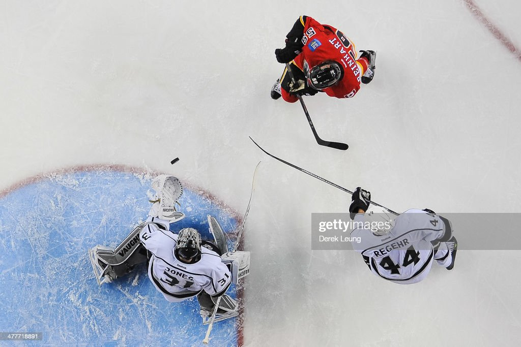 Max Reinhart #59 of the Calgary Flames takes a shot at the net of Martin Jones #31 of the Los Angeles Kings during an NHL game at Scotiabank Saddledome on March 10, 2014 in Calgary, Alberta, Canada. The Kings defeated the Flames 3-2.