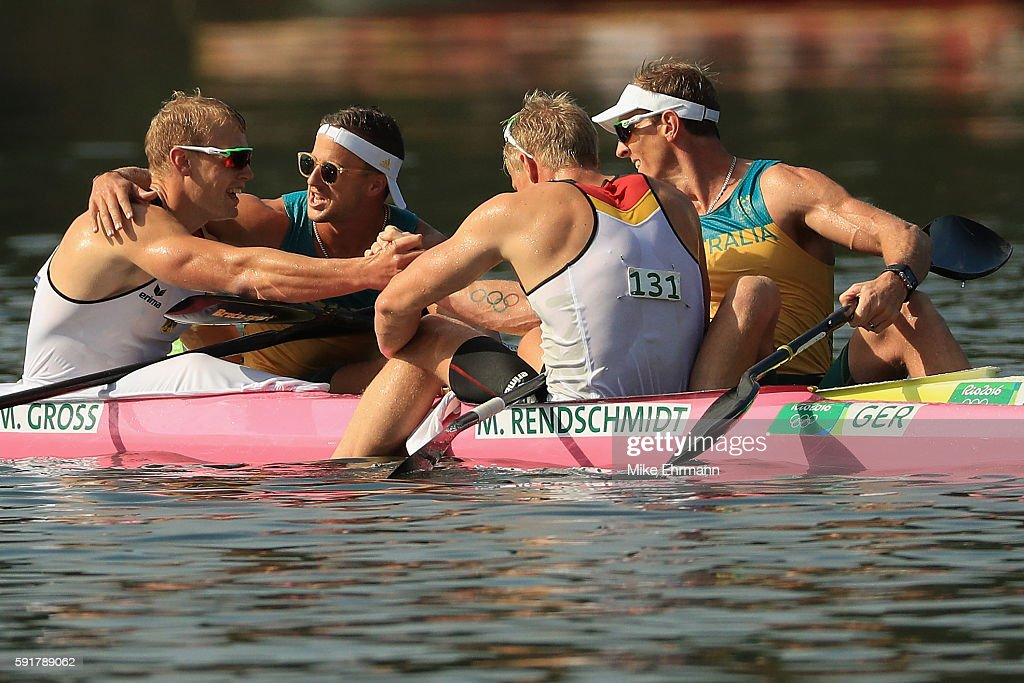 Max Rendschmidt and Marcus Gross of Germany react with Ken Wallace and Lachlan Tame of Australia after winning gold and bronze respectively in the Men's Kayak Double 1000m event at the Lagoa Stadium on Day 13 of the 2016 Rio Olympic Games on August 18, 2016 in Rio de Janeiro, Brazil.
