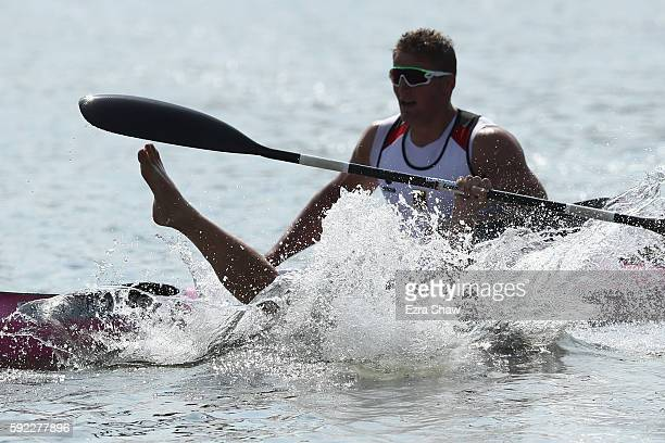 Max Rendschmidt of Germany jumps into the water after winning the gold medal in the Men's Kayak Four 1000m Finals on Day 15 of the Rio 2016 Olympic...