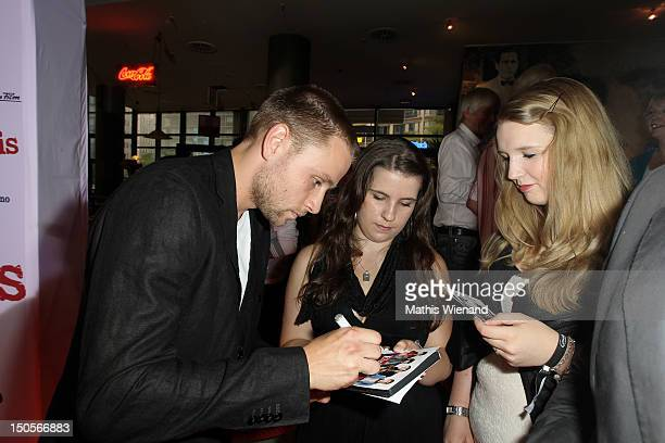 Max Riemelt attends the 'Heiter Bis Wolkig' Germany Premiere at Cinedome on MediaPark on August 21 2012 in Cologne Germany