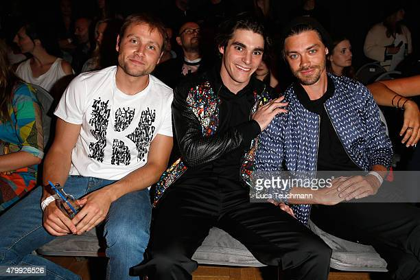 Max Riemelt RJ Mitte and Tom Payne attend the Kilian Kerner show during the MercedesBenz Fashion Week Berlin Spring/Summer 2016 at on July 8 2015 in...