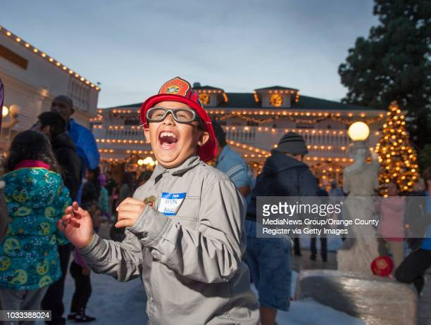 Max Rodriquez screams as he watches his snowball hit it's mark during the annual Winter Wonderland Meal at the Anaheim White House The more than 300...