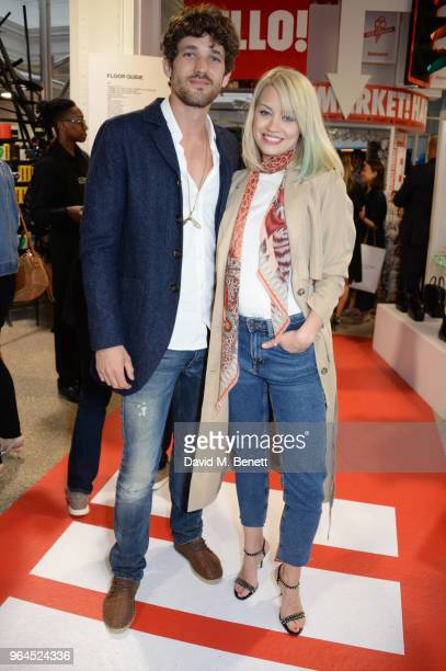 Max Rogers and Kimberly Wyatt attend Hello Magazine's 30th anniversary party at Dover Street Market on May 9 2018 in London England