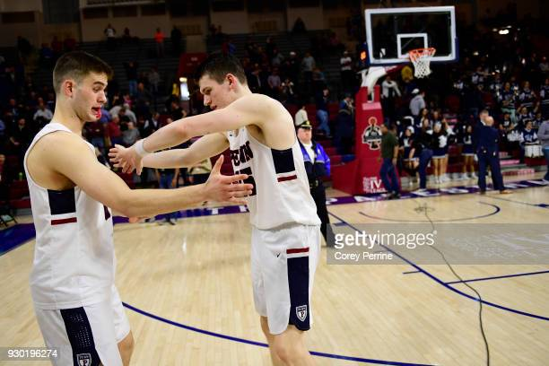 Max Rothschild and AJ Brodeur of the Pennsylvania Quakers celebrate the win after the game of a semifinal round matchup against the Yale Bulldogs in...