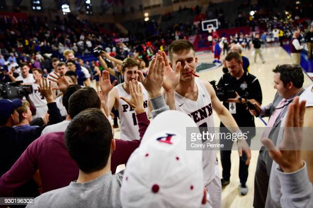 Max Rothschild is highfived followed by Caleb Wood of the Pennsylvania Quakers after the win against the Yale Bulldogs of a semifinal round matchup...