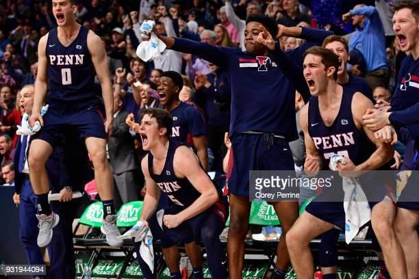 Max Rothschild Jackson Donahue Jarrod Simmons Matt MacDonald and Collin McManus of the Pennsylvania Quakers erupt on the bench after a three point...