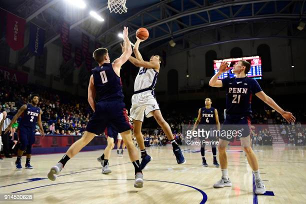 Max Rothschild of the Pennsylvania Quakers defends against Paul Atkinson of the Yale Bulldogs during the first half at The Palestra on February 3...
