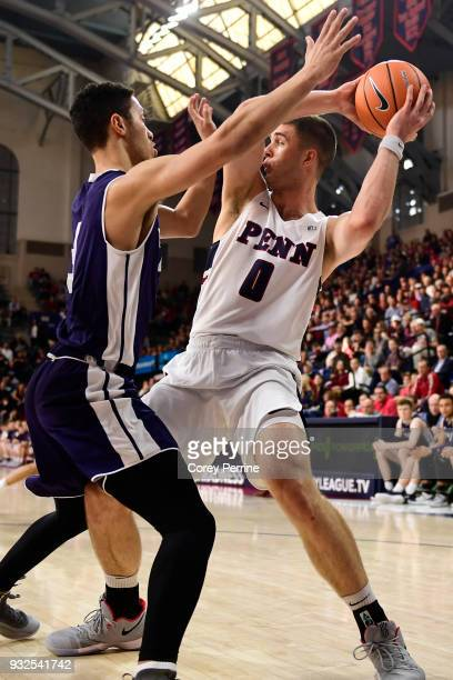 Max Rothschild of the Pennsylvania Quakers looks to pass against Alex Copeland of the Yale Bulldogs during the first half of a semifinal round...