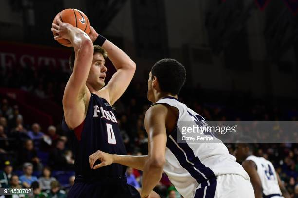 Max Rothschild of the Pennsylvania Quakers looks to pass against Paul Atkinson of the Yale Bulldogs during the second half at The Palestra on...