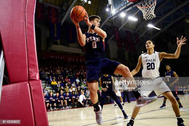 Max Rothschild of the Pennsylvania Quakers looks to pass while making a save out of bounds against Paul Atkinson of the Yale Bulldogs during the...