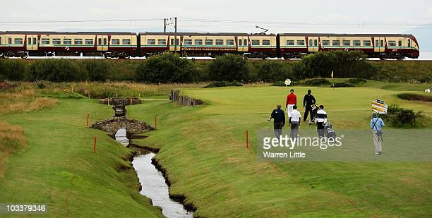 Max Rottluff of Germany and Conor O'Neil of Scotland walk down the 4th hole as a train passes by during the quarter final of the Boys Amateur...