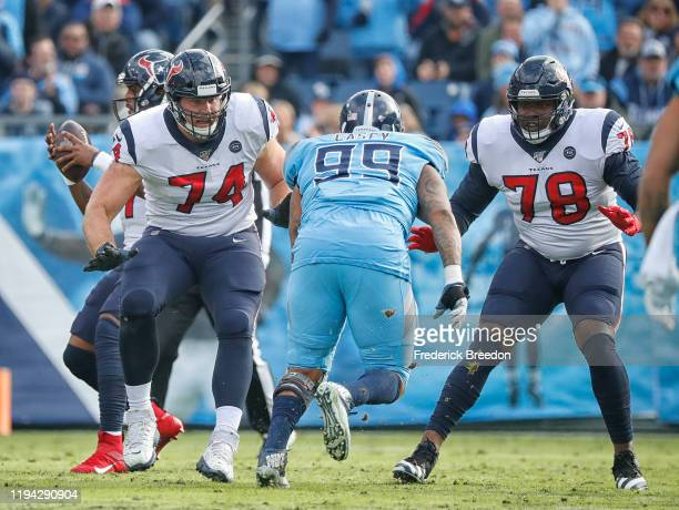 Max Scharping and Laremy Tunsil of the Houston Texans block Jurrell Casey of the Tennessee Titans at Nissan Stadium on December 15, 2019 in...