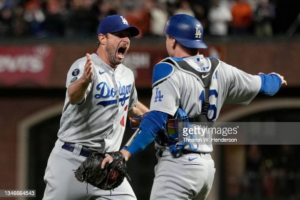 Max Scherzer and Will Smith of the Los Angeles Dodgers celebrate after beating the San Francisco Giants 2-1 in game 5 of the National League Division...
