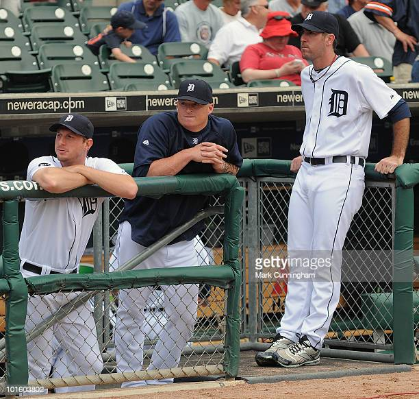 Max Scherzer Jeremy Bonderman and Justin Verlander of the Detroit Tigers look on from the dugout during the game against the Cleveland Indians at...
