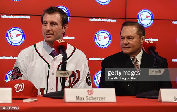 Max Scherzer, newly acquired pitcher for the Washington Nationals, talks with the media during his introductory press conference with agent Scott...