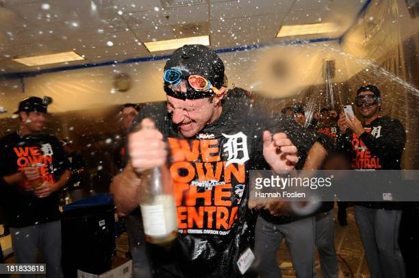 Max Scherzer of the Detroit Tigers celebrates with champagne in the clubhouse after the Tigers defeated the Twins 10 on September 25 2013 at Target...