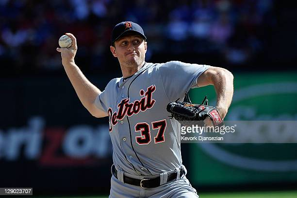 Max Scherzer of the Detroit Tigers throws a pitch against the Texas Rangers in Game Two of the American League Championship Series at Rangers...