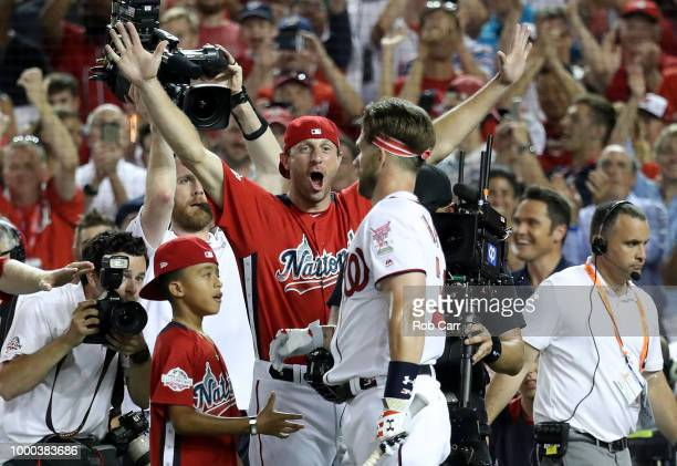 Max Scherzer of the Washington Nationals and the National League celebrates with Bryce Harper of the Washington Nationals and National League after...
