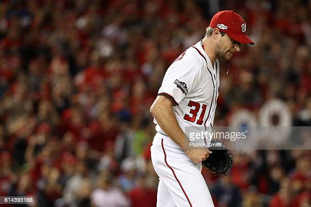 Max Scherzer of the Washington Nationals celebrates after throwing a strike out for the second strike out of the fourth inning against the Los...