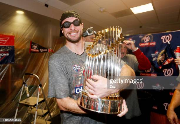 Max Scherzer of the Washington Nationals celebrates in the locker room after defeating the Houston Astros in Game Seven to win the 2019 World Series...