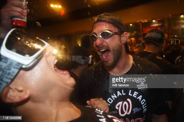 Max Scherzer of the Washington Nationals celebrates with teammates in the clubhouse after they won game four and the National League Championship...
