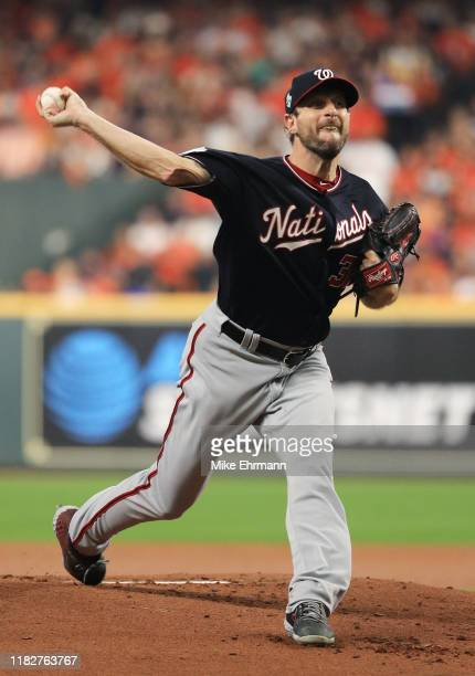 Max Scherzer of the Washington Nationals delivers the pitch against the Houston Astros during the first inning in Game One of the 2019 World Series...