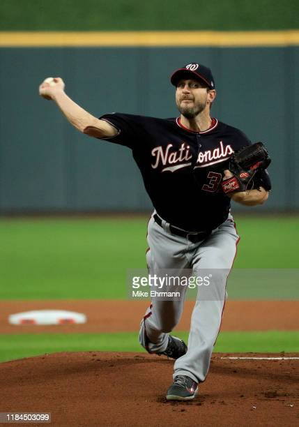 Max Scherzer of the Washington Nationals delivers the pitch against the Houston Astros during the first inning in Game Seven of the 2019 World Series...
