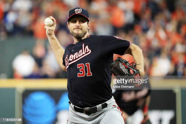 Max Scherzer of the Washington Nationals delivers the pitch against the Houston Astros during the second inning in Game Seven of the 2019 World...