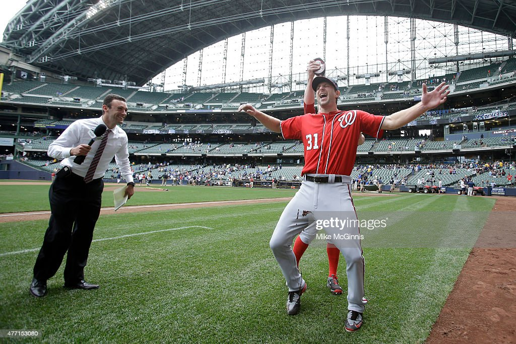 Max Scherzer #31 of the Washington Nationals get doused in chocolate sauce after pitching a one hitter in the 4-0 win over the Milwaukee Brewers at Miller Park on June 14, 2015 in Milwaukee, Wisconsin.