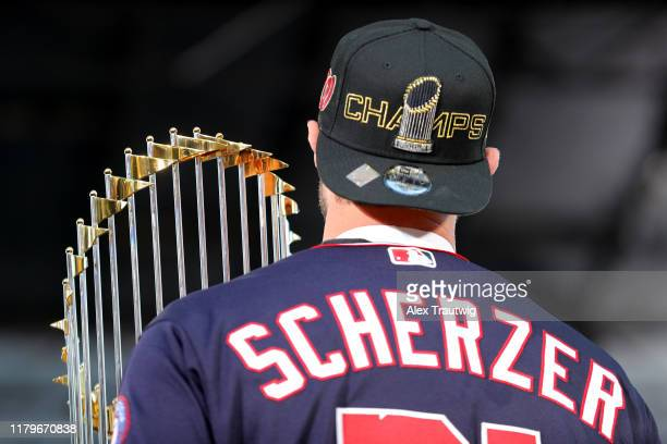 Max Scherzer of the Washington Nationals holds the Commissioner's Trophy during the 2019 World Series victory parade on Saturday November 2 2019 in...