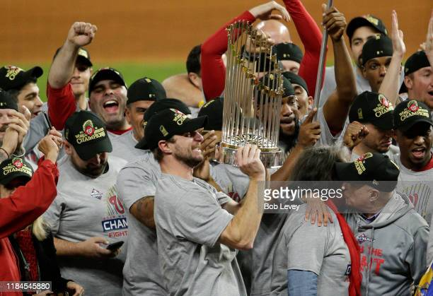 Max Scherzer of the Washington Nationals holds the Commissioners Trophy after defeating the Houston Astros 62 in Game Seven to win the 2019 World...