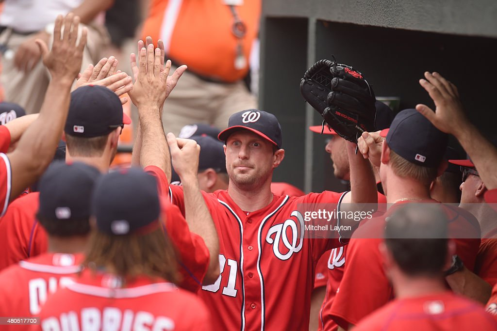 Max Scherzer #31 of the Washington Nationals is congratulated on his performance after getting taken out in the ninth inning a baseball game against the Baltimore Orioles at Oriole Park at Camden Yards on July 12, 2015 in Baltimore, Maryland. The Nationals won 3-2.