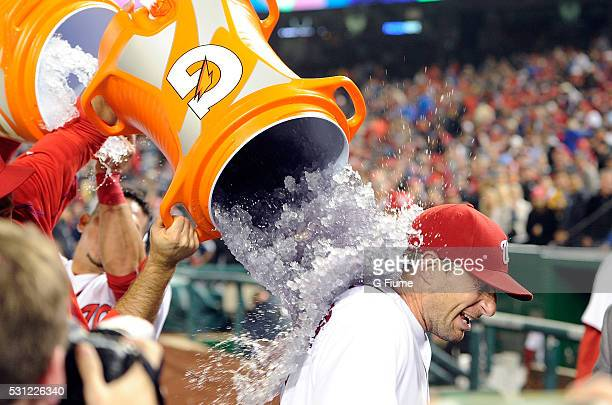 Max Scherzer of the Washington Nationals is doused with Gatorade after tying the MLB record for strikeouts in a game with 20 against the Detroit...