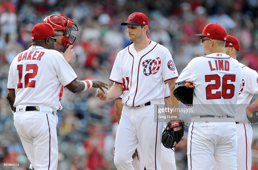 Max Scherzer #31 of the Washington Nationals is taken out of the game by manager Dusty Baker #12 in the eighth inning against the Texas Rangers at Nationals Park on June 11, 2017 in Washington, DC. Texas won the game 5-1.